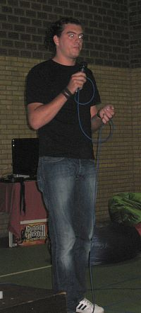 Photo of student with microphone.