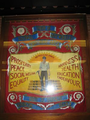 Photo of the National Union of Mineworkers banner.